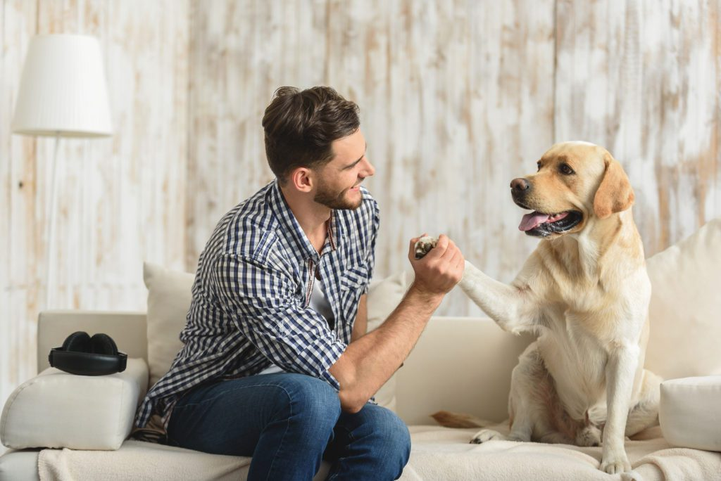 Man and his Dog in a house