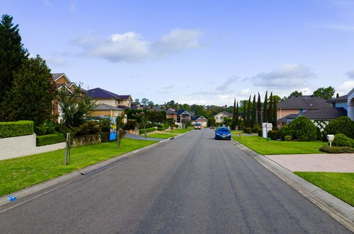 Beautiful street with homes indicating a potential home owners association