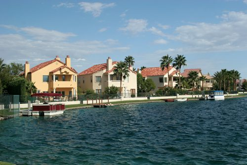 Homes are shown lake front in The Lakes Neighborhood