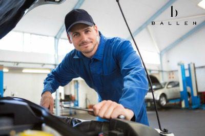 mechanic smiling at camera
