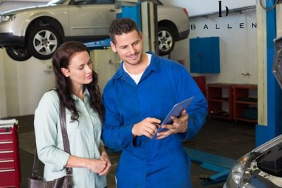 mechanic talking to woman about repairs