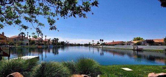 Desert Shores Lake showing homes around the edge