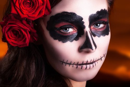 Face is painted for the day of the dead celebration in Las Vegas