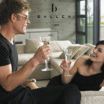 couple laughing drinking champagne