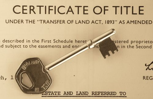 Certificate of Title with a Key placed on top