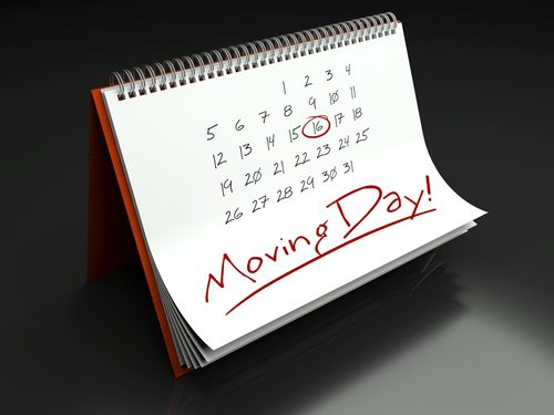 Calendar with the words Moving Day written and the 16th is circled in red