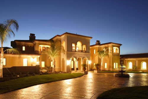 Beautiful night shot of a luxury home with lights on