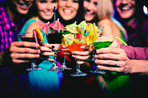 Group of women giving cheers with fancy cocktails