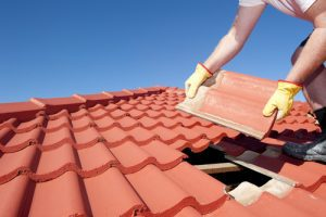Tiles in the roof are being repaired during Nevada national rebuilding day