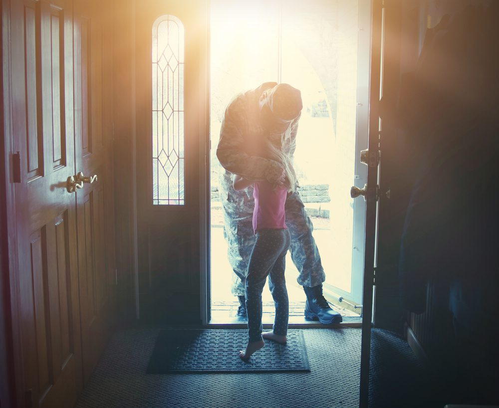 Home is possible for heroes father and daughter in doorway