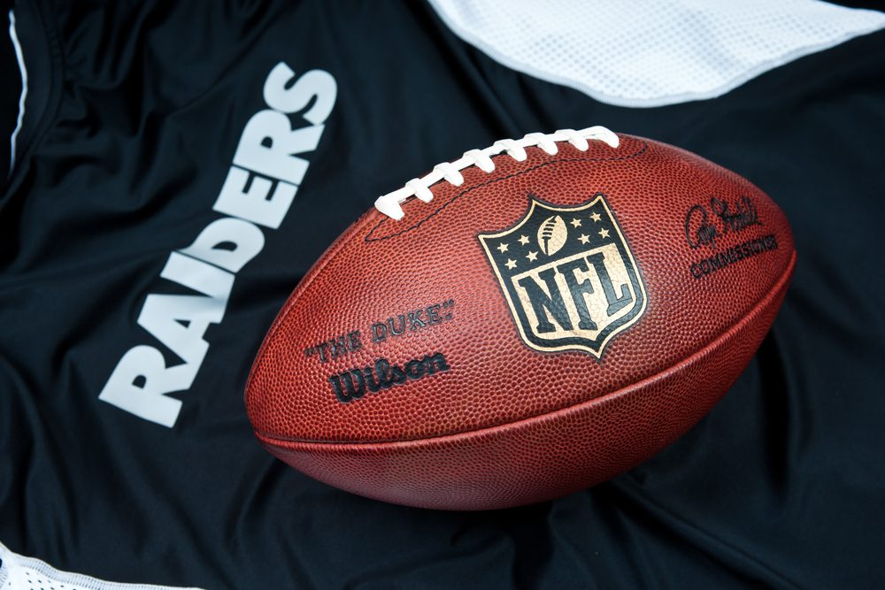Football Jersey and Football depicting the Raiders Football Team