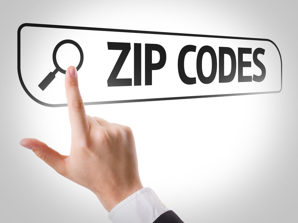 Man has his finger pointing to a computer search with the words Zip Codes in the search bar