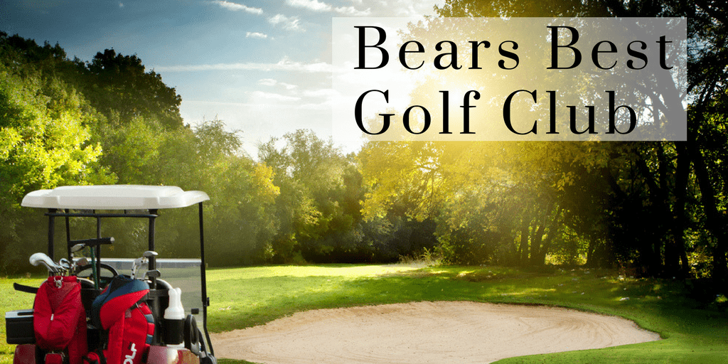 Red Golf Cart sits on a golf course with trees and words read Bears Best Golf Club