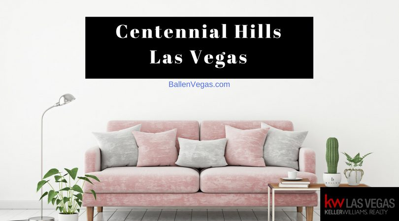 Pink Couch with Grey Pillows and lamps and plants are in a living room. Sign reads Centennial Hills Las Vegas