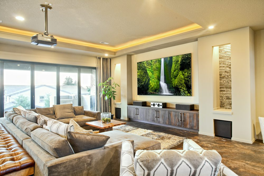 Living Room in a nice home, flat screen television, couch, chair, large sliding glass door