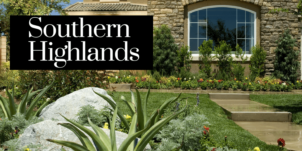 Home with green landscaping and the words Southern Highlands