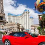 fancy red car driving in Las Vegas