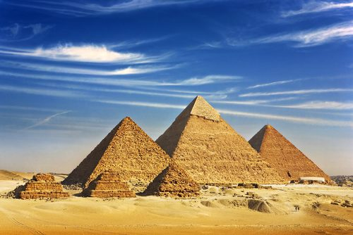 Pyramids of Giza against a blue sky