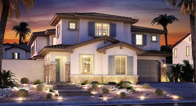 "Lennar Homes Model Home ""Tide"" at Delano in Summerlin shows lit house against dark sky"