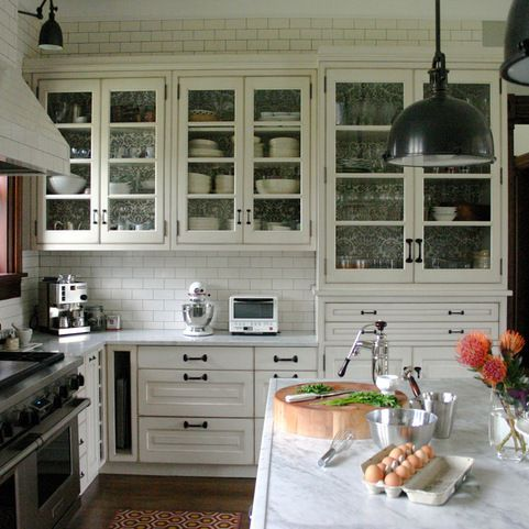 White Kitchen with cabinets, island, and window sash pulls