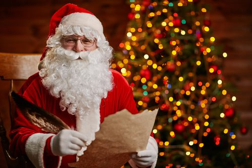 Photos with Santa and Santa is holding his naughty or nice list