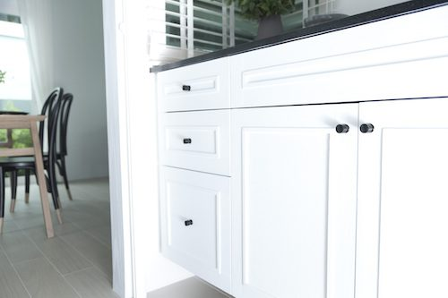 Kitchen cabinets and drawers show a class kitchen knob