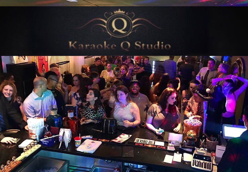 Picture of a group of people in a small bar at Karaoke Q Studio for Karaoke in Las Vegas