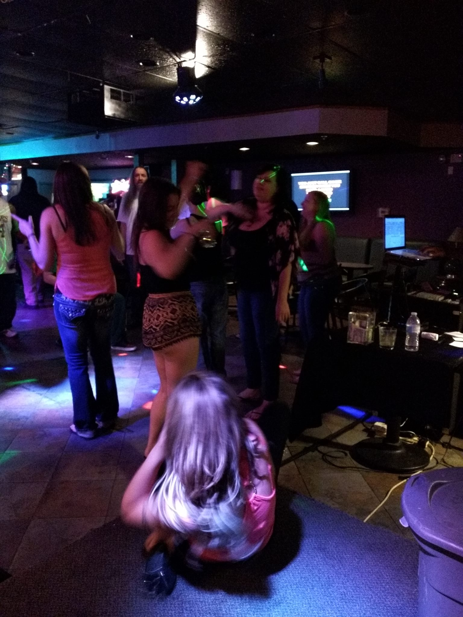 People are on the dance floor during a karaoke las vegas event at Pandoras Karaoke Bar