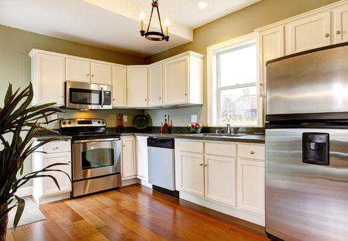 Kitchen in a condo in las vegas is updated with new cabinets and flooring