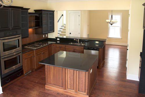 dark kitchen, hardwood floors, island