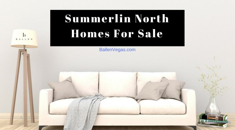 Couch in a living room with throw and pillows, wall sign reads summerlin north homes for sale