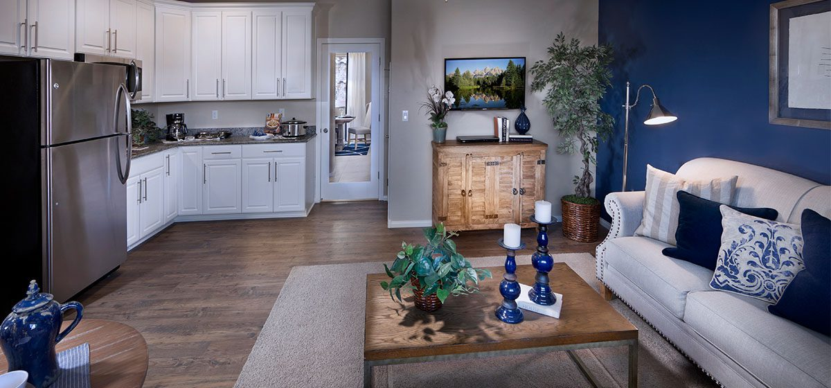 Beautiful open floorplan of the Ashmore next gen home with in-law quarters by Lennar in Southwest Las Vegas. White cupboards, hardwood floors, blue accents