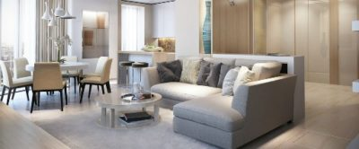 Nice clean Condo with grey couch, table, brown and grey colors