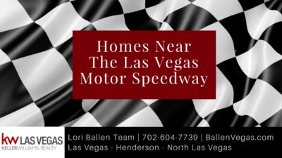 Checkered race flag is on a banner with a burgandy box with letters that spell out Homes Near The Las Vegas Motor Speedway