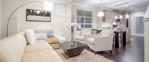 open floor plan of condo with white furnishings