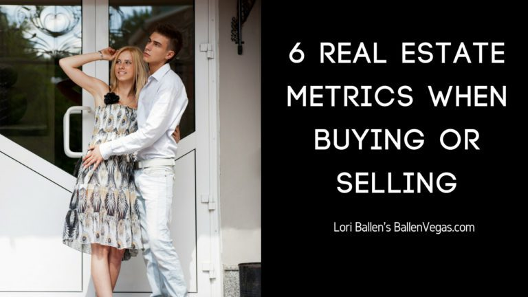 Young couple is standing in front of real estate and the sign next to them reads 6 real estate market metrics when buying or selling