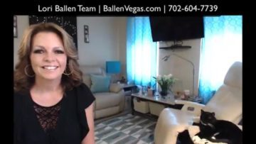 Lori Ballen is making a video on how much is realtor commissions when selling a house in las vegas. She is in her living room and her cat gideon is nearby