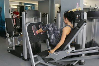 A woman exercising on a leg machine