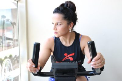 A woman on a stationary bicycle