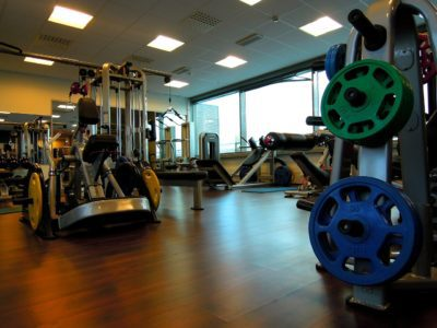 A gym with many exercise equipment