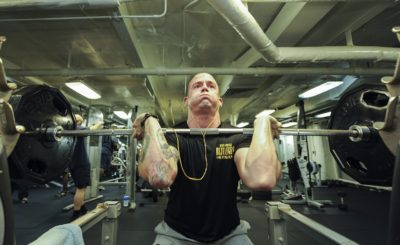 A man doing heavy weight lifting