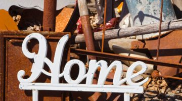 The word home looks like it's in an old sign yard maybe