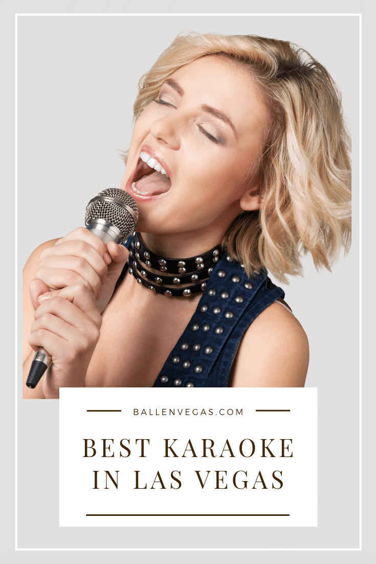 Girl has her mouth open and is singing into a microphone at what looks like karaoke