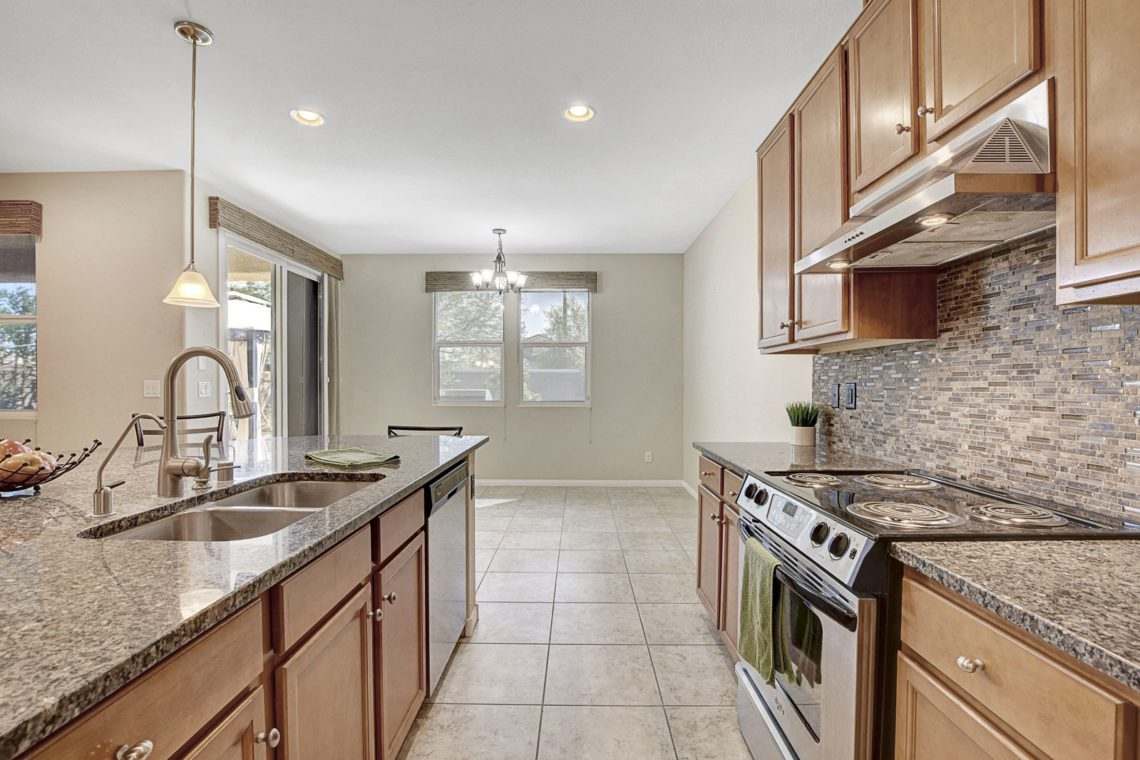 Located in the highly desirable area near Aliante close to parks, shopping & dining! Home features a large open kitchen with a huge island and all stainless steel appliances.